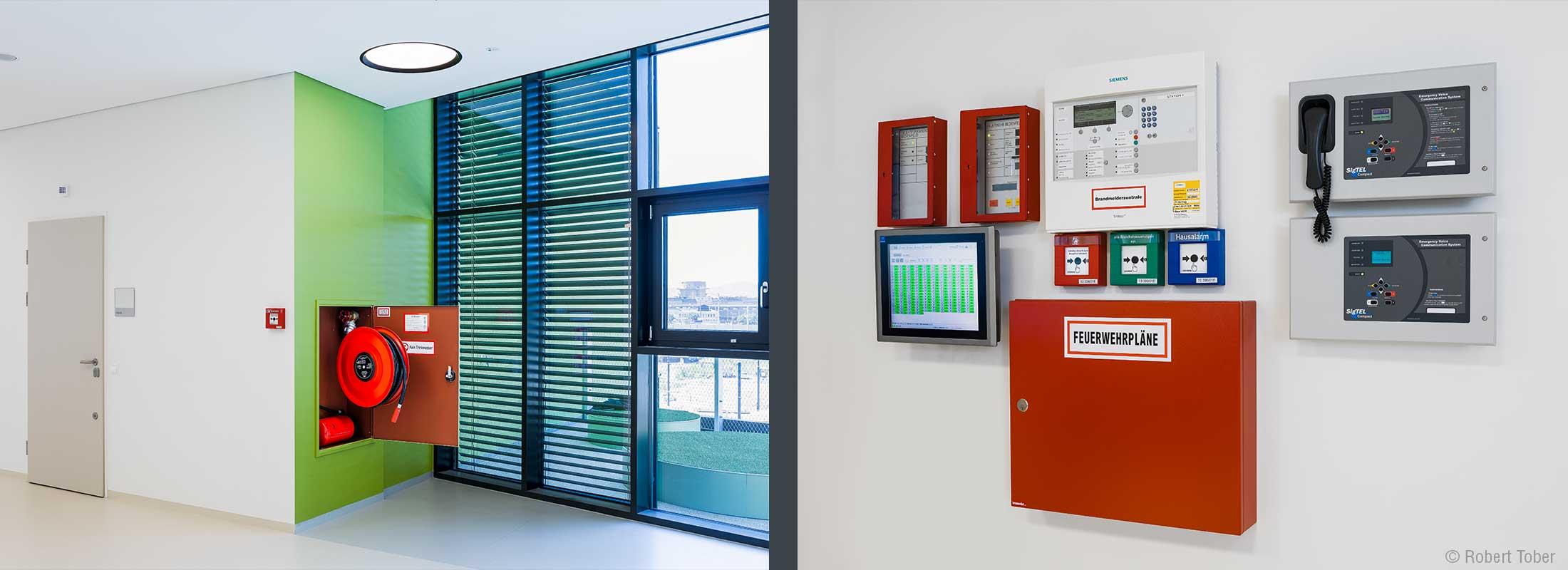 Wandhydrant und Feuerlöscher. Brandmeldezentrale. Christine Nöstlinger Campus Wien. © Robert Tober